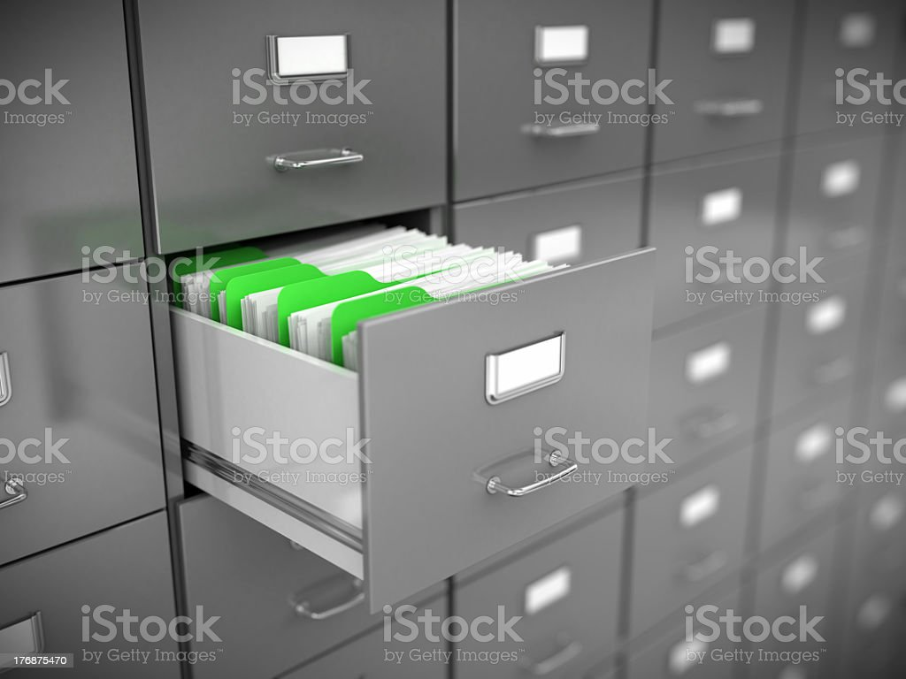 Open filing cabinet drawer with green dividers stock photo