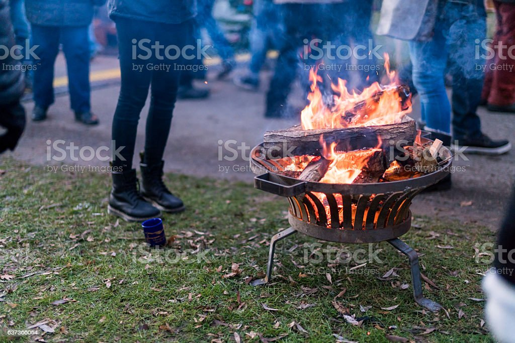 Open fire warms visitors to Christmas Fair by the Lake stock photo