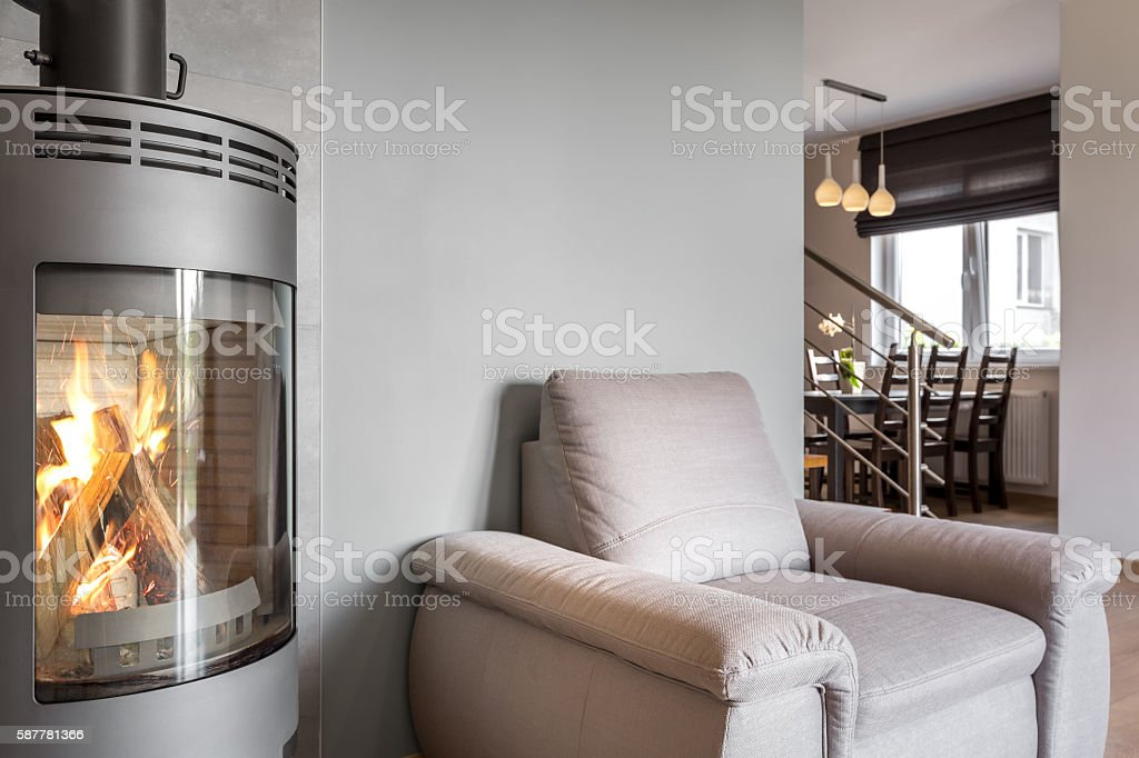 Open floor apartment with a fireplace idea stock photo