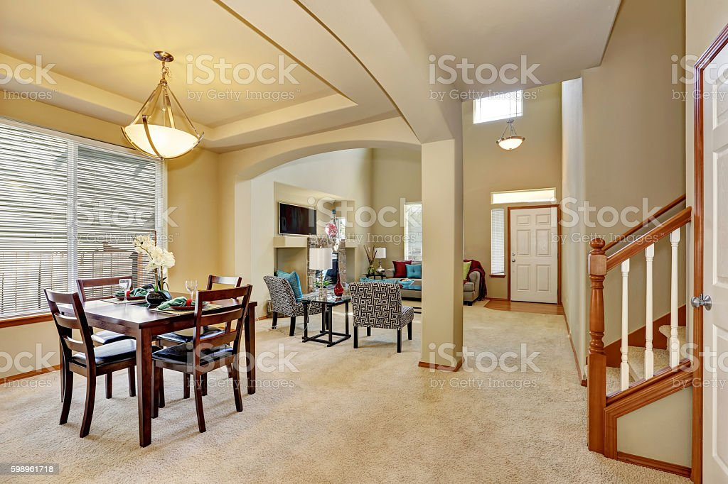 Open floor plan. Dining area and living room with entryway stock photo