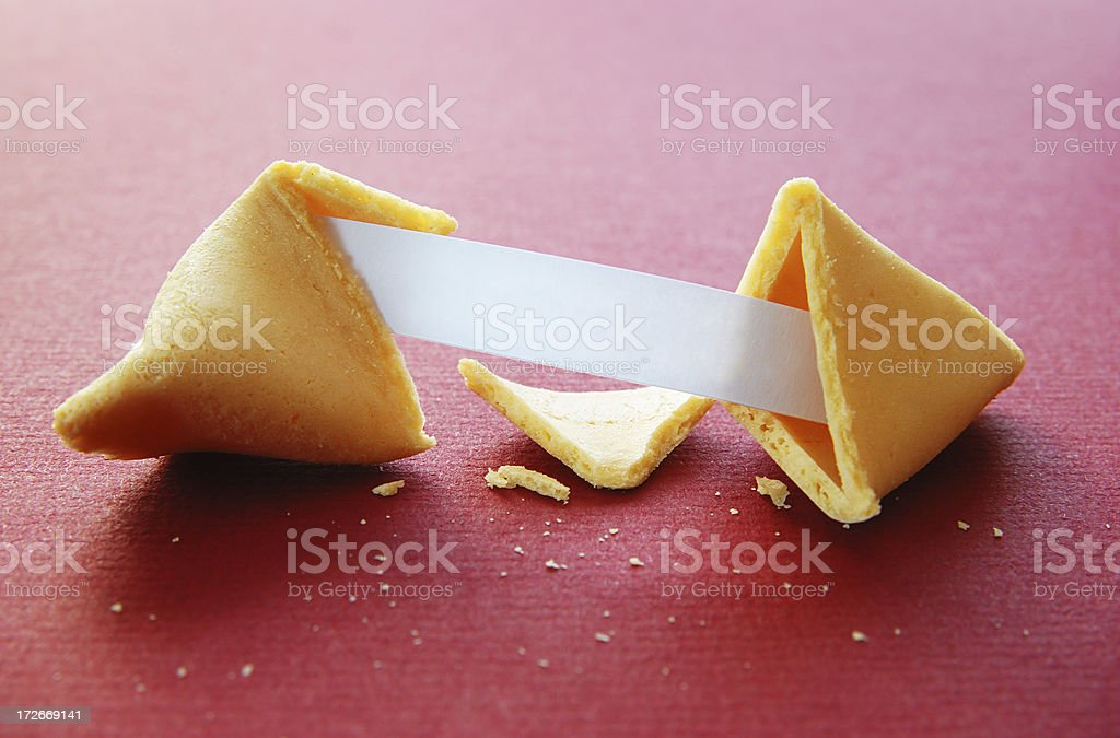 Open fortune cookie with blank fortune royalty-free stock photo