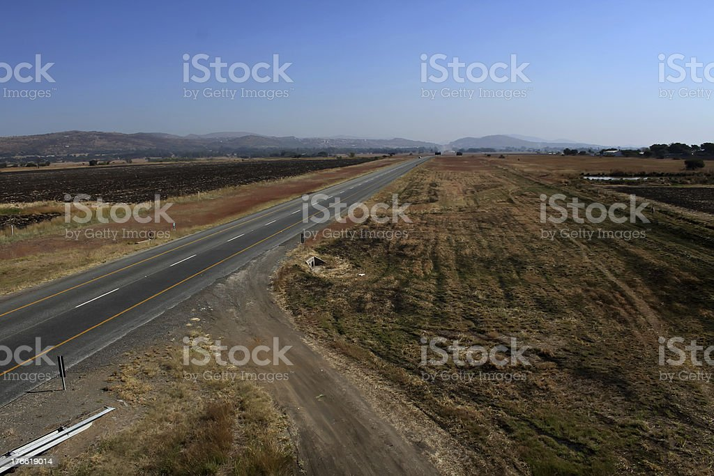 Open Freeway with Sand Road Junction royalty-free stock photo
