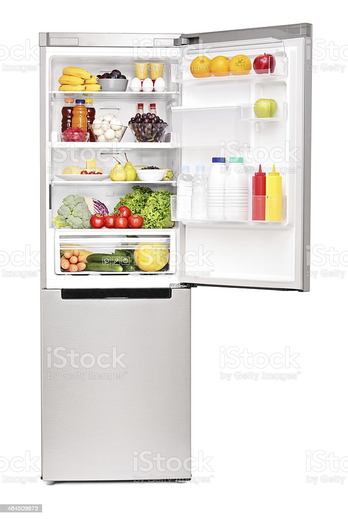 Open fridge full of healthy food products stock photo