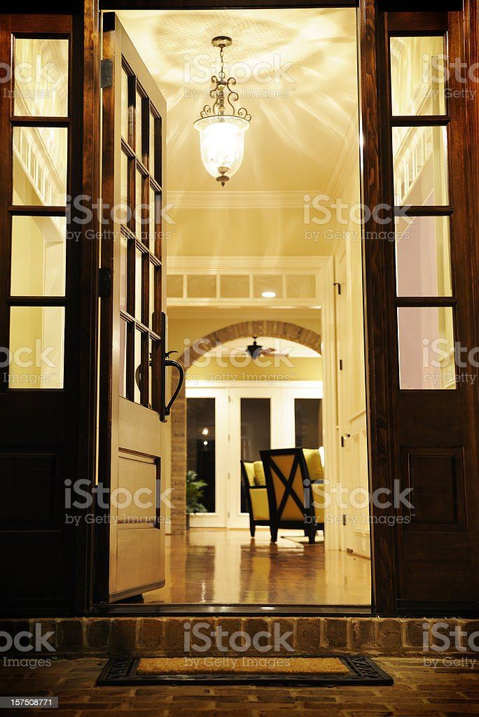 Open front door for a classical living room royalty-free stock photo