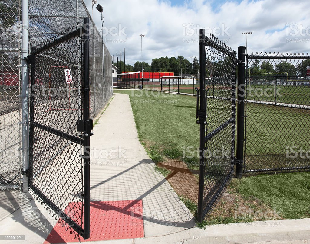 Open gate leads to youth baseball complex.   Welcome. stock photo