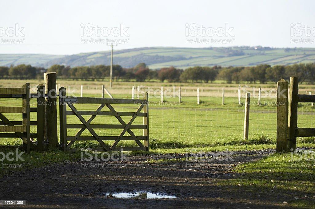 Open gate to farm fields royalty-free stock photo