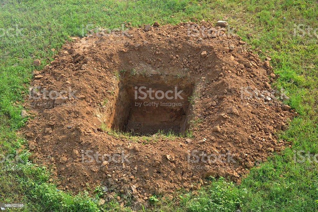 Open grave stock photo