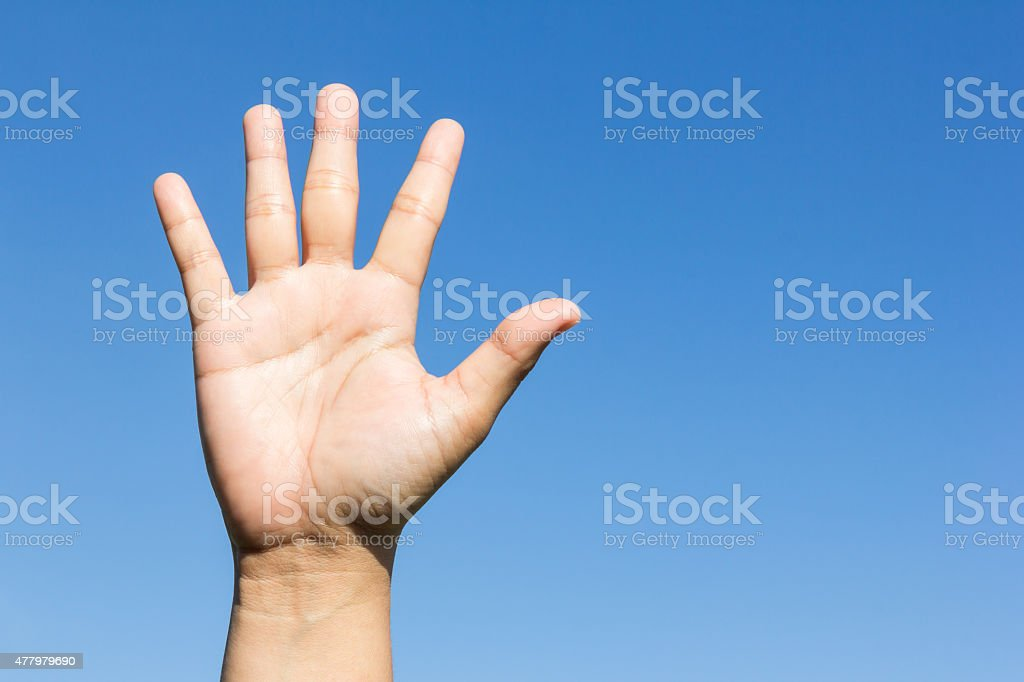 open hand on sky background stock photo
