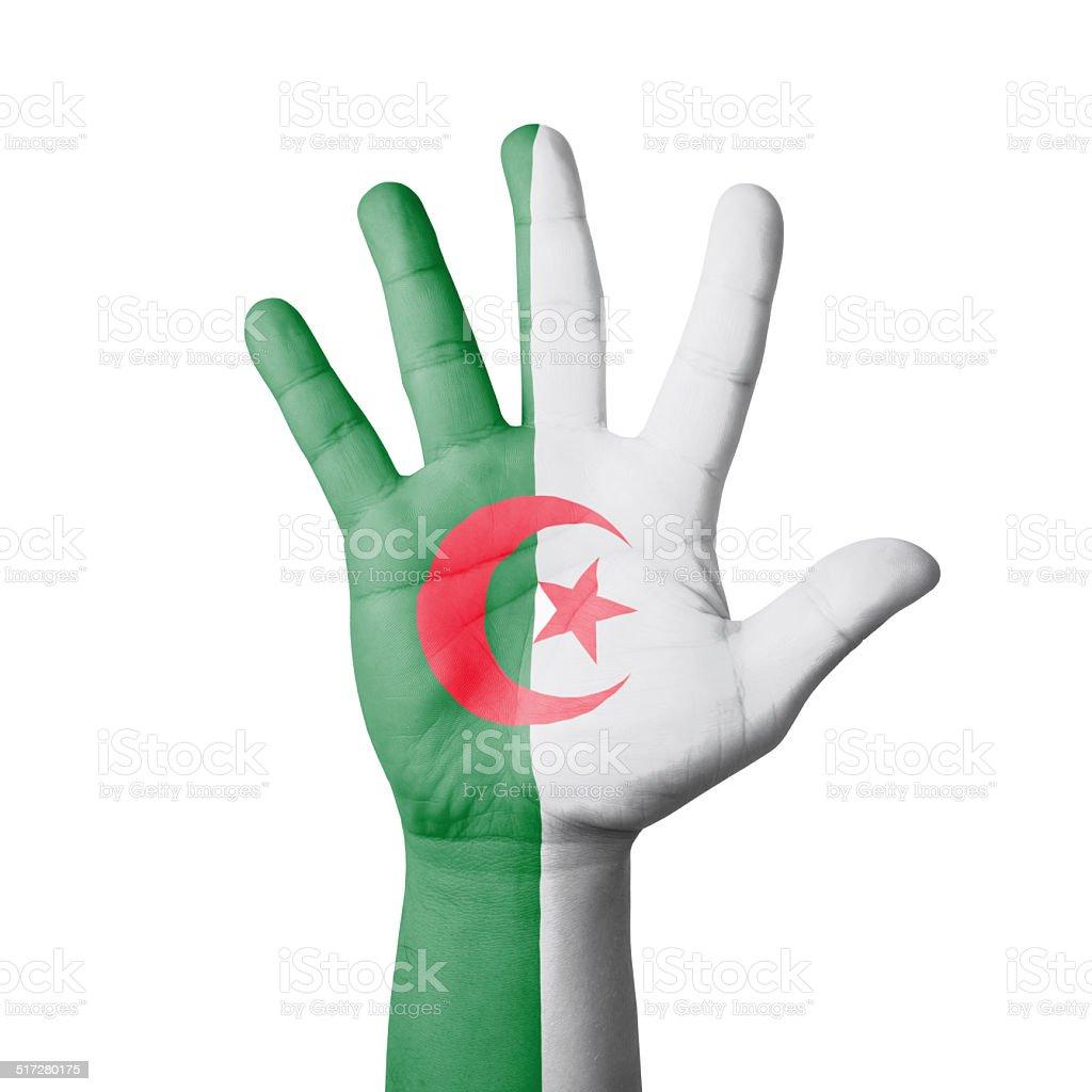 Open hand raised, Algeria flag painted stock photo