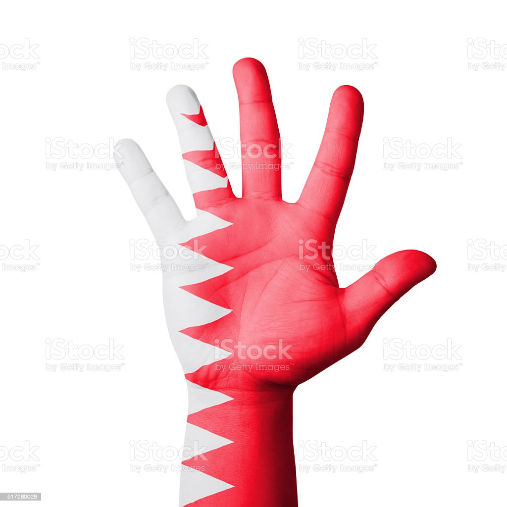 Open hand raised, Bahrain flag painted stock photo