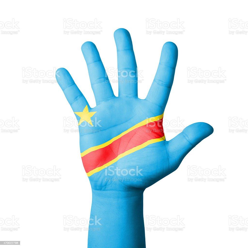 Open hand raised, Congo flag painted stock photo