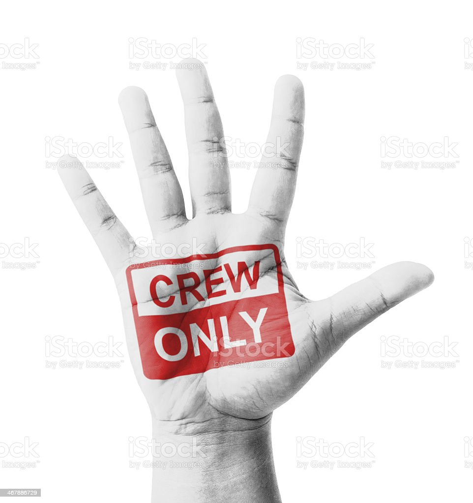 Open hand raised, Crew Only sign painted stock photo