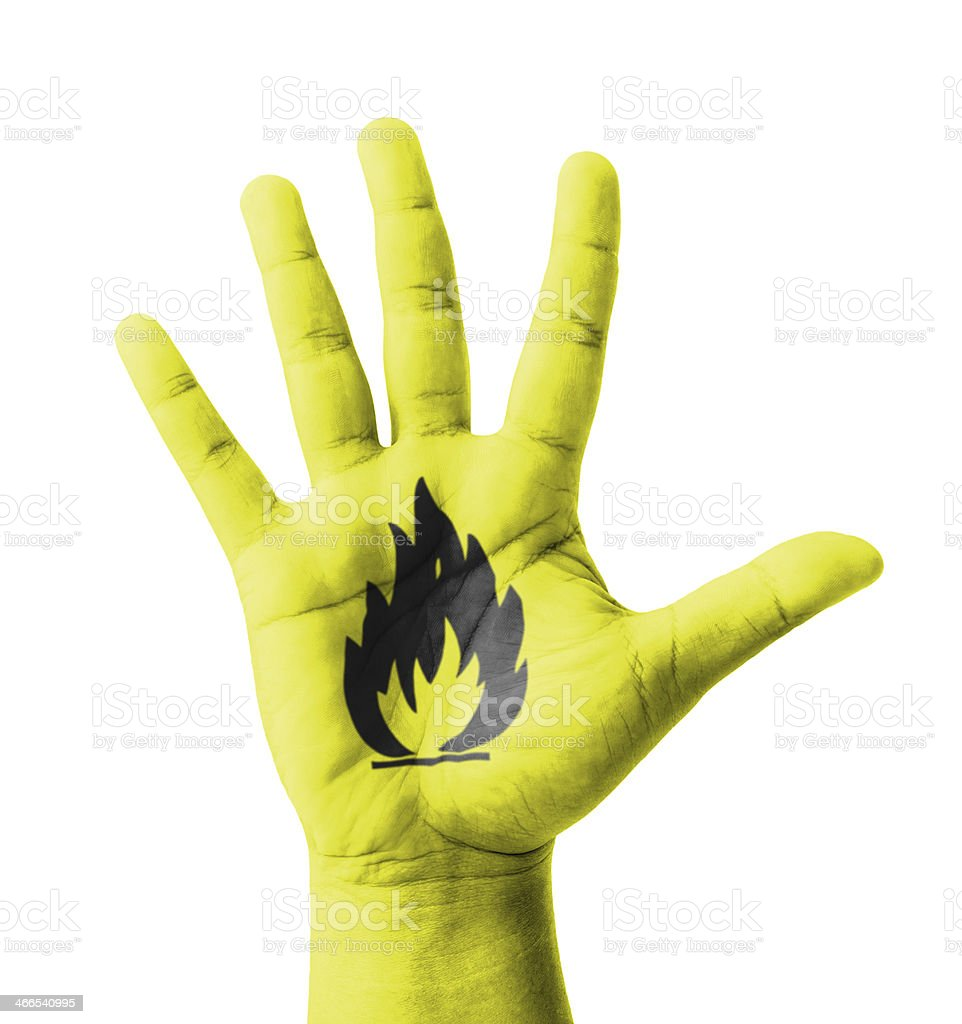 Open hand raised, Flammable sign painted stock photo
