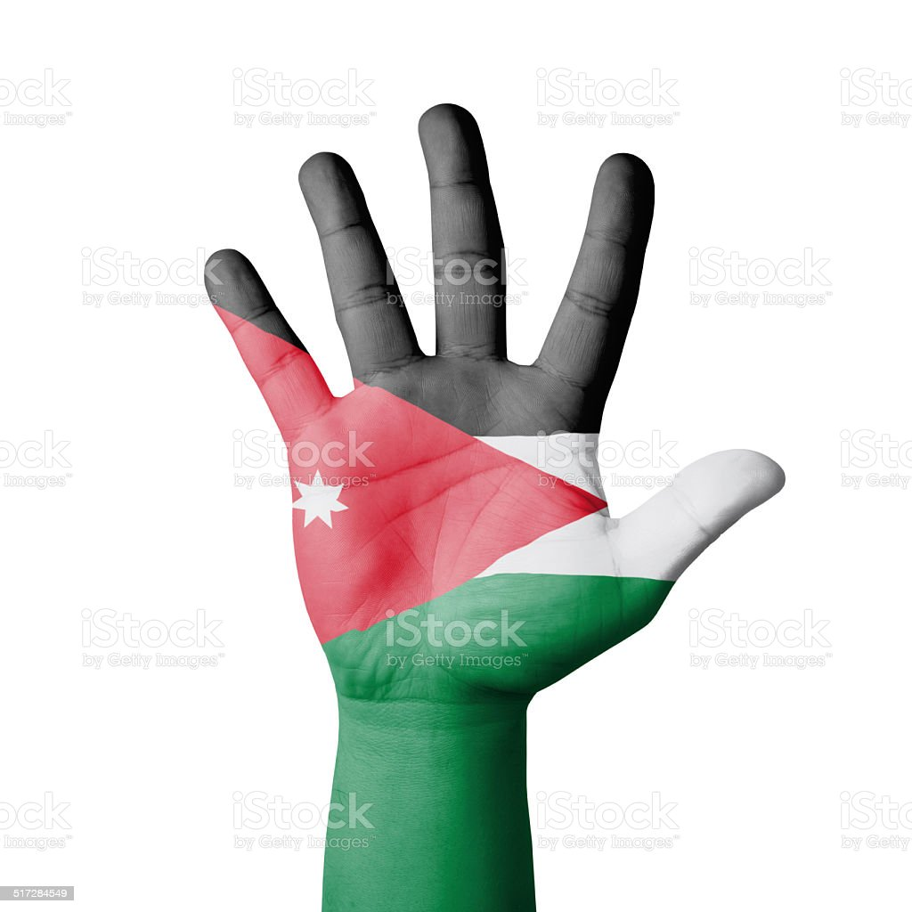 Open hand raised, Jordan flag painted stock photo