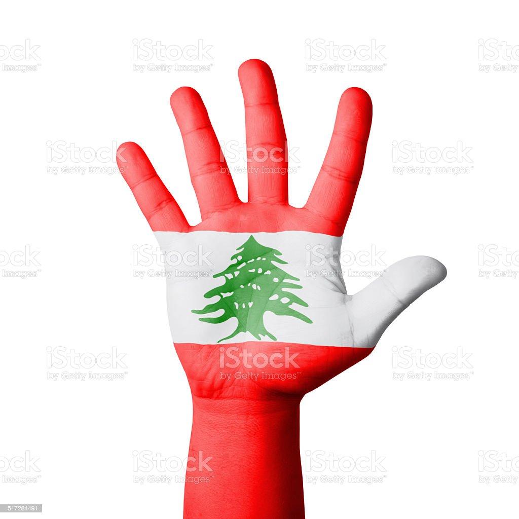 Open hand raised, Lebanon flag painted stock photo