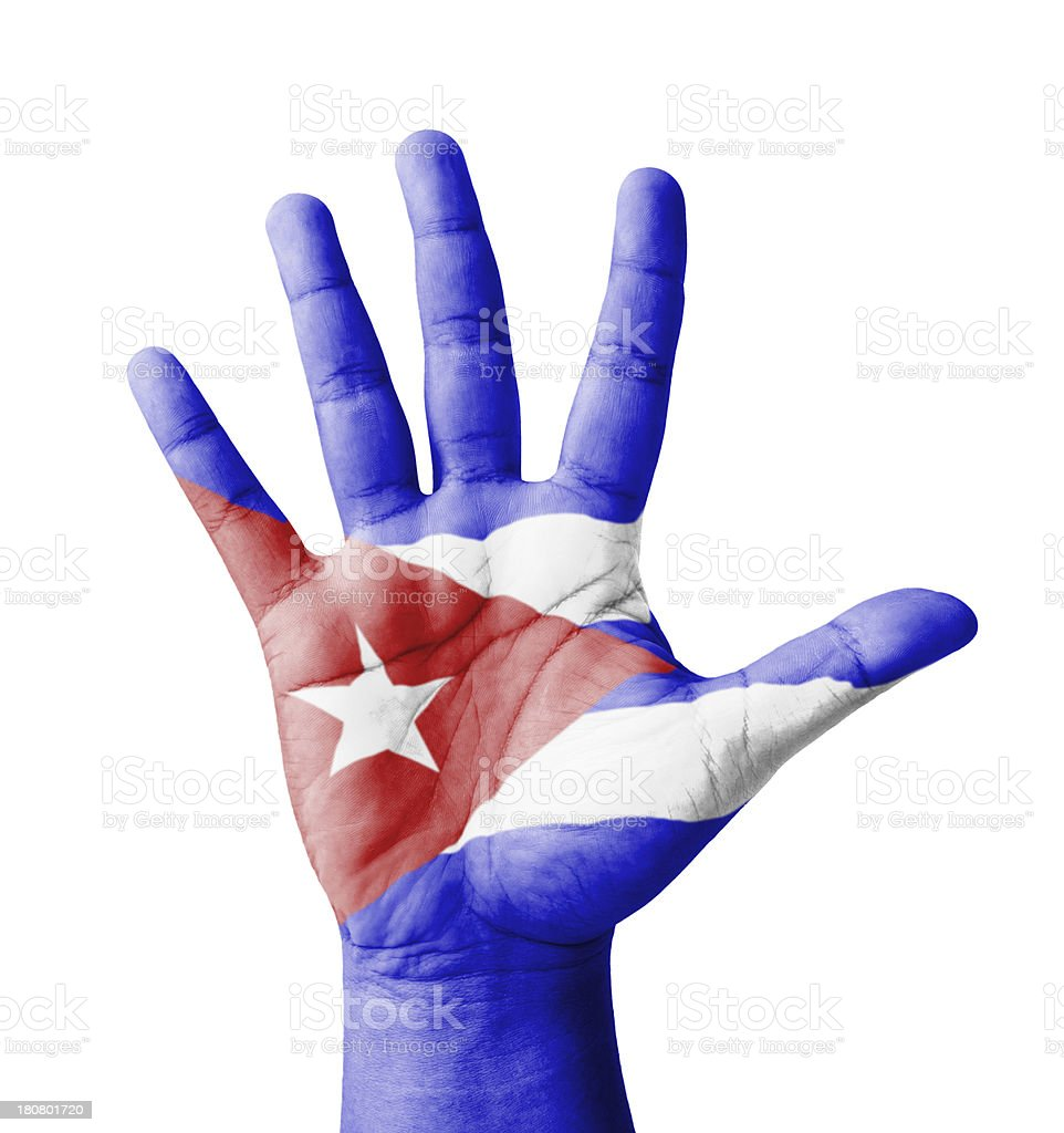 Open hand raised, multi purpose concept, Cuba flag painted royalty-free stock photo