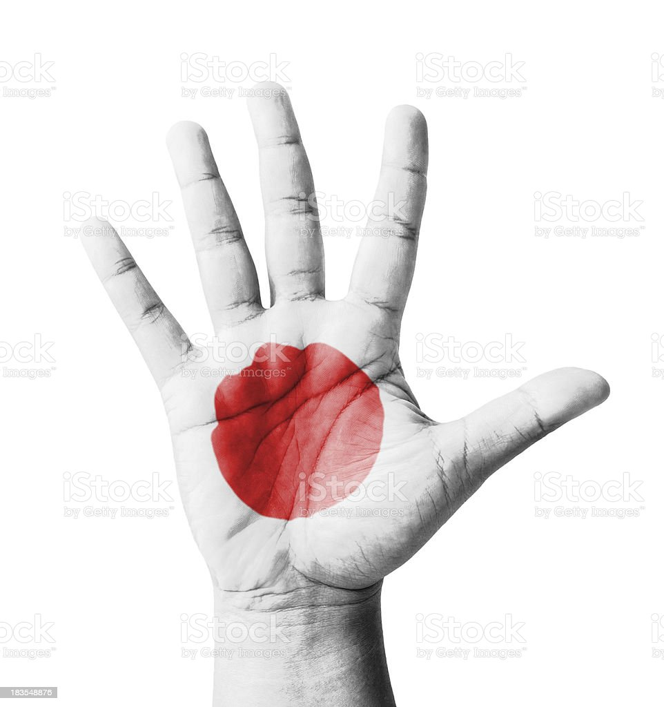 Open hand raised, multi purpose concept, Japan flag painted stock photo