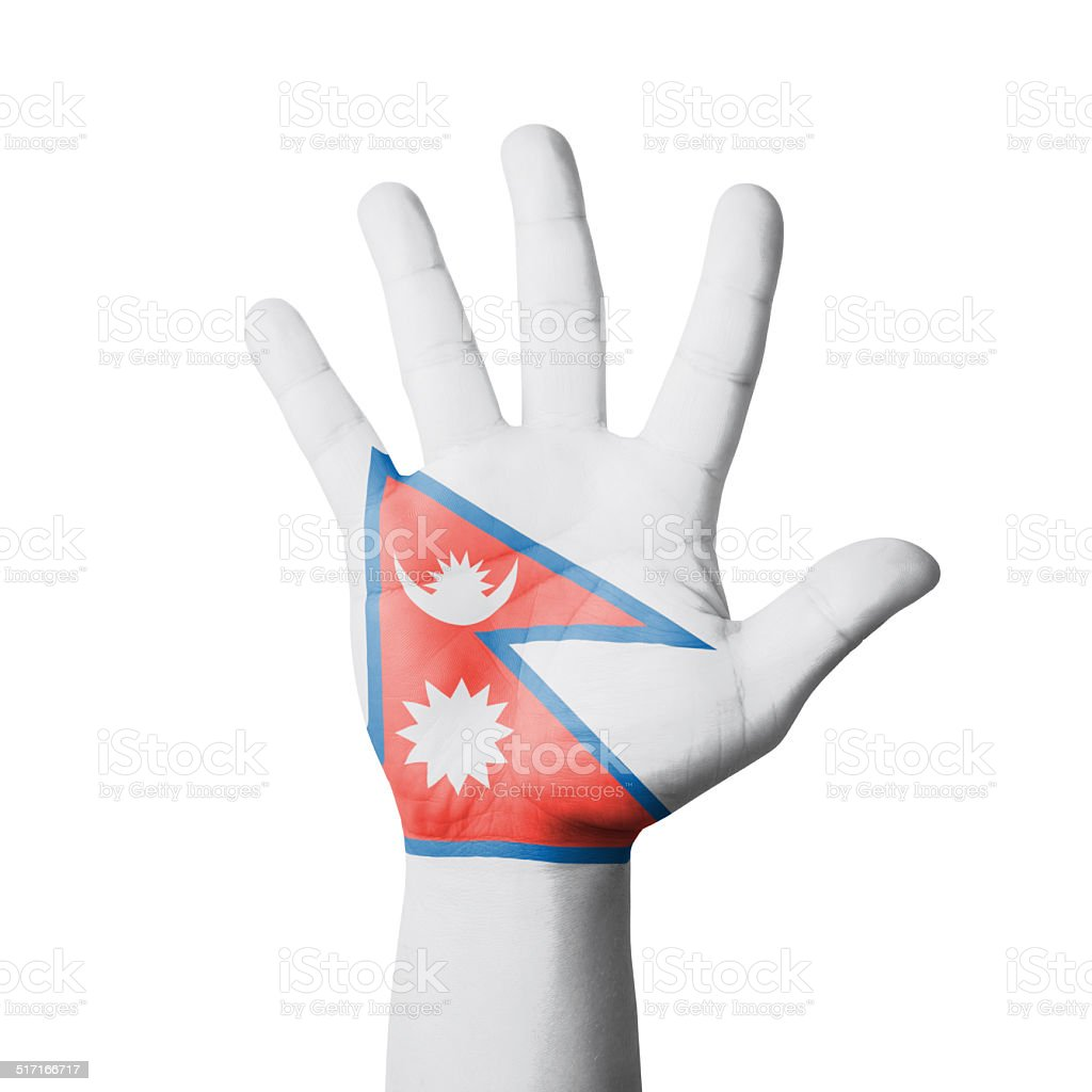 Open hand raised, Nepal flag painted stock photo