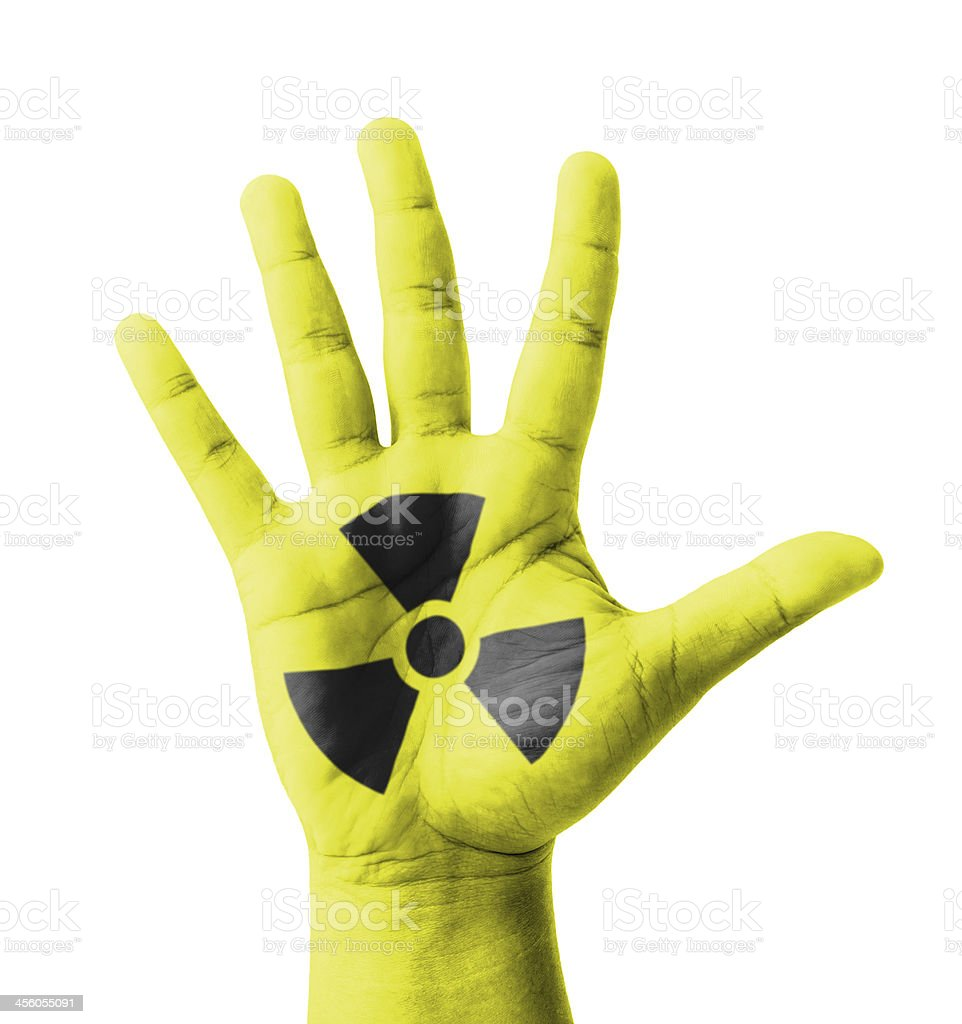 Open hand raised, Nuclear sign painted stock photo