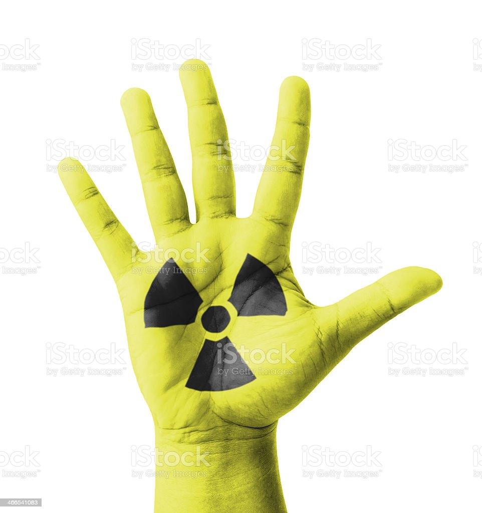 Open hand raised, Radioactivity sign painted stock photo
