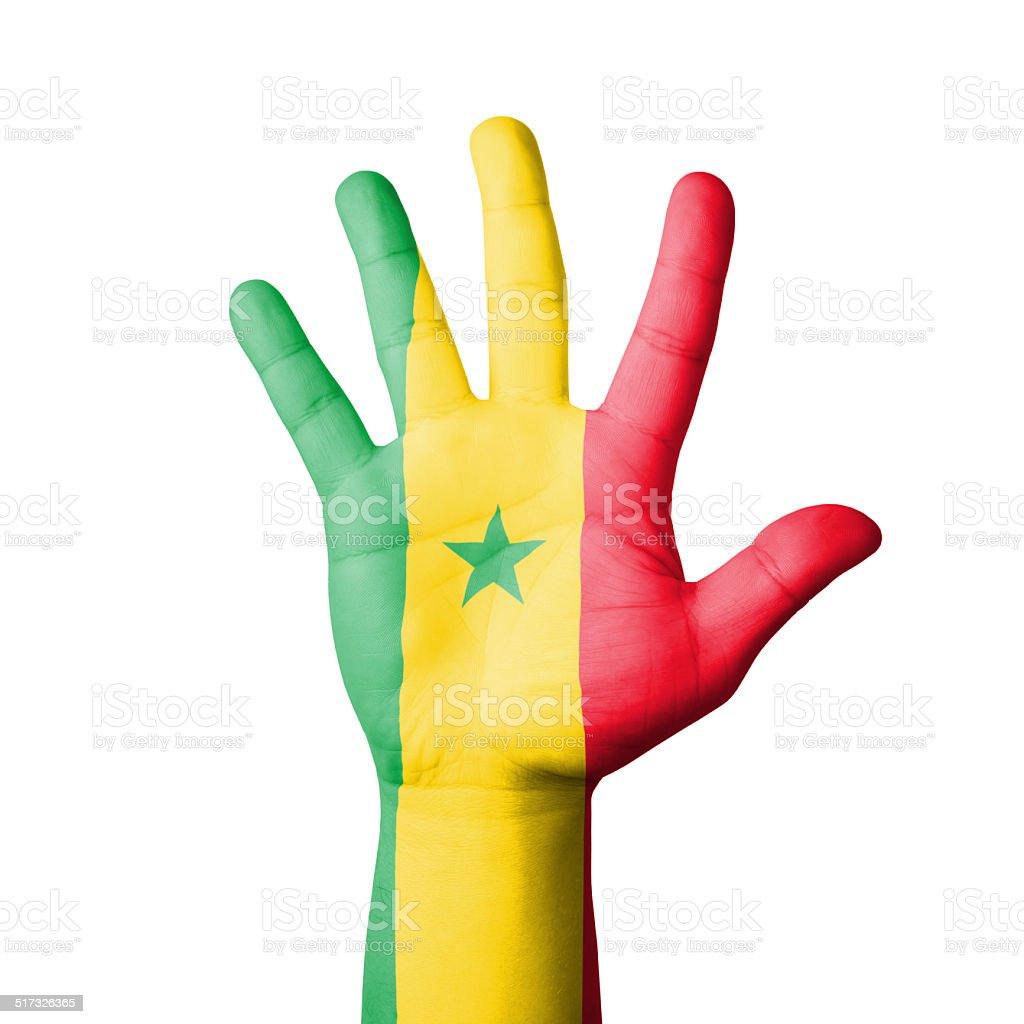 Open hand raised, Senegal flag painted stock photo