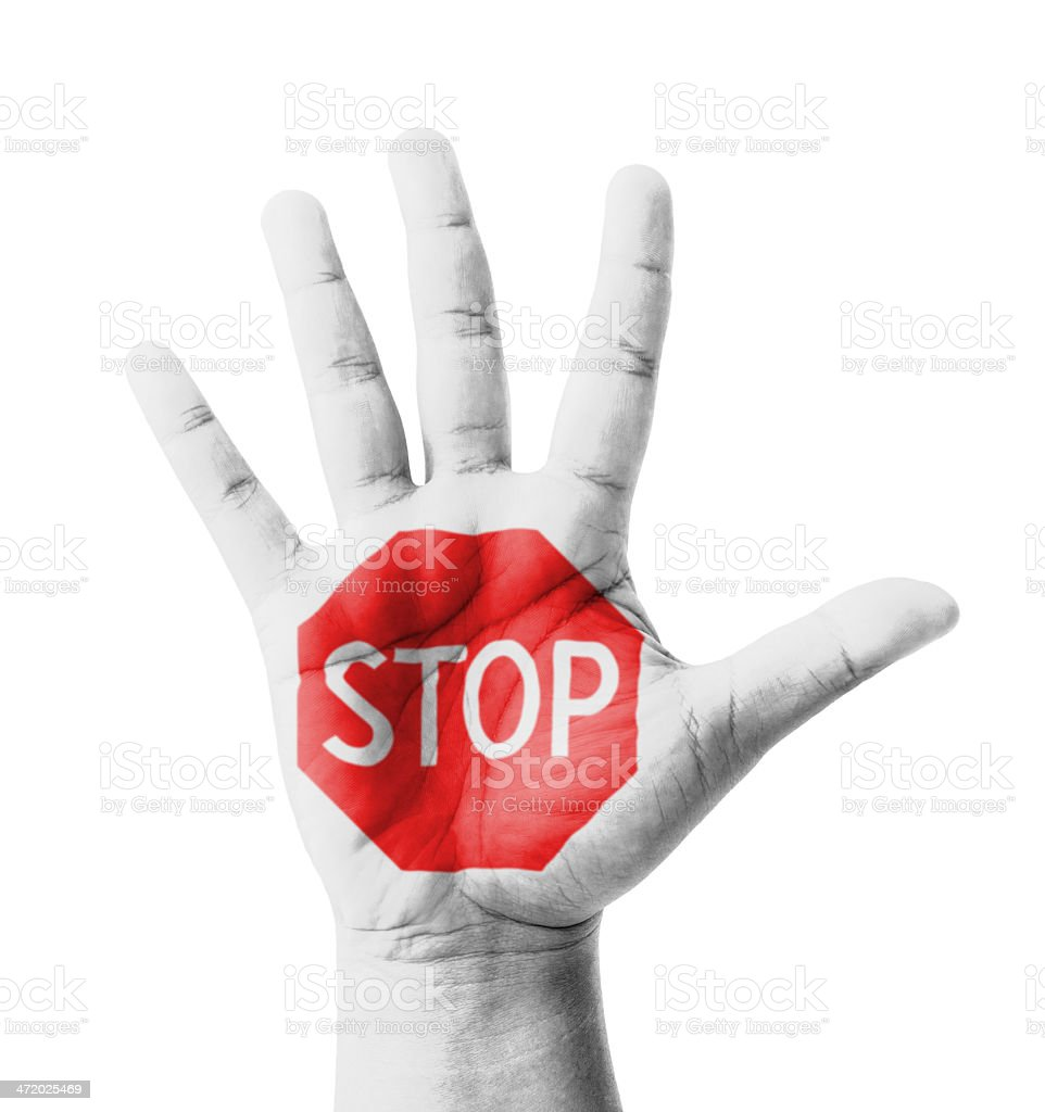 Open hand raised, STOP sign painted stock photo