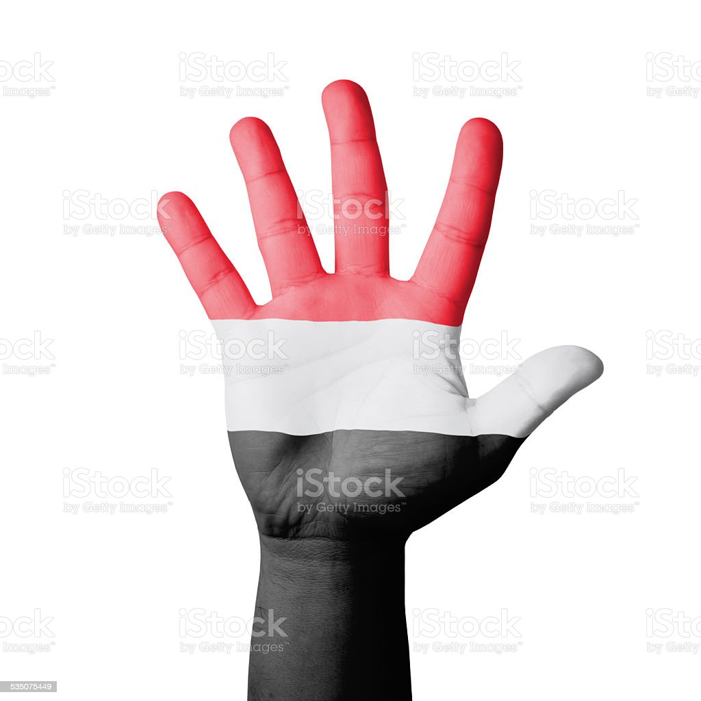 Open hand raised, Yemen flag painted stock photo