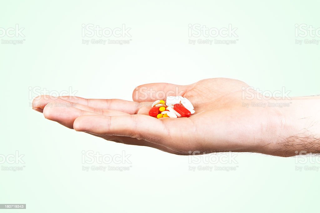 Open hand with medicine royalty-free stock photo