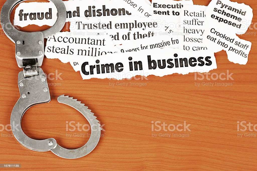 Open handcuffs emphasise 'fraud' in headlines on white collar crime stock photo