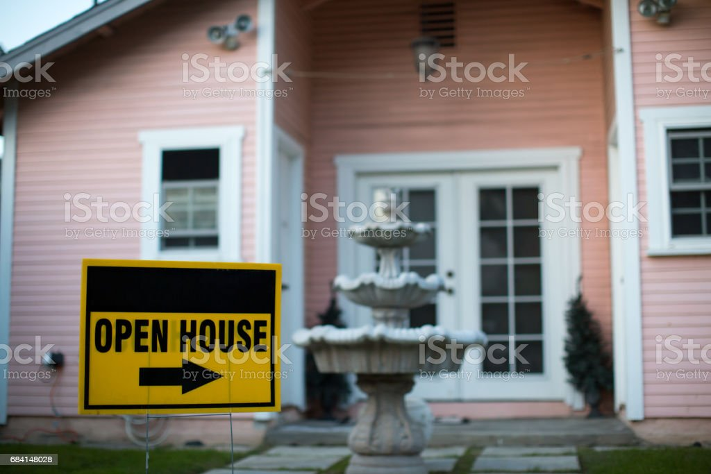 Open house sign in front of a home stock photo