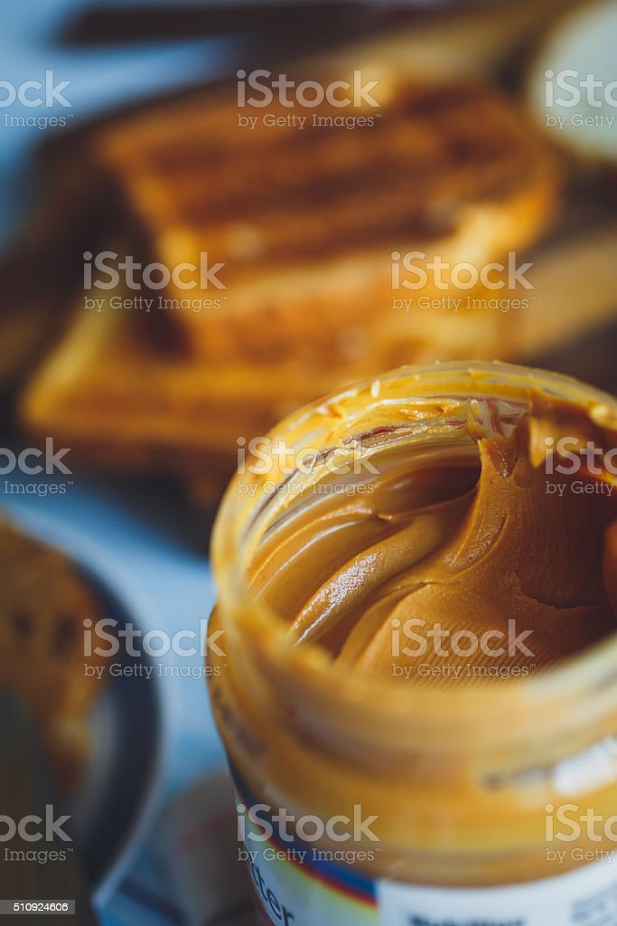 Open jar of peanut butter stock photo