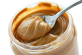 open jar of peanut butter with spoon
