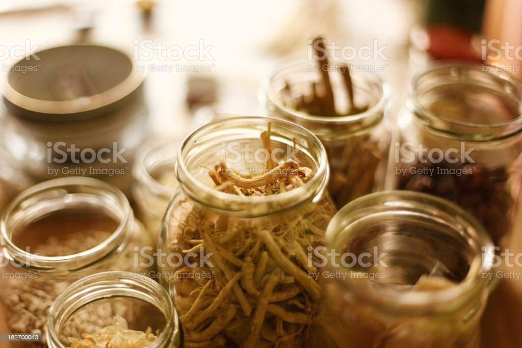 Open jars of Chinese herbal medicine stock photo