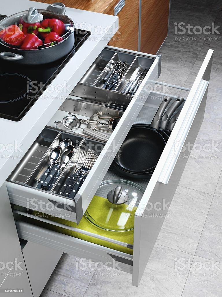 Open kitchen drawers stock photo