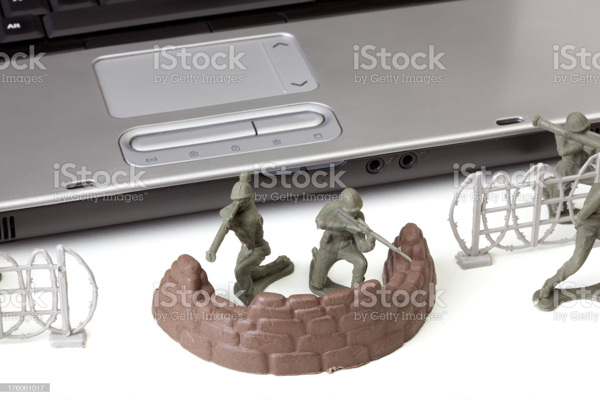 Open laptop computer with toy soldiers royalty-free stock photo