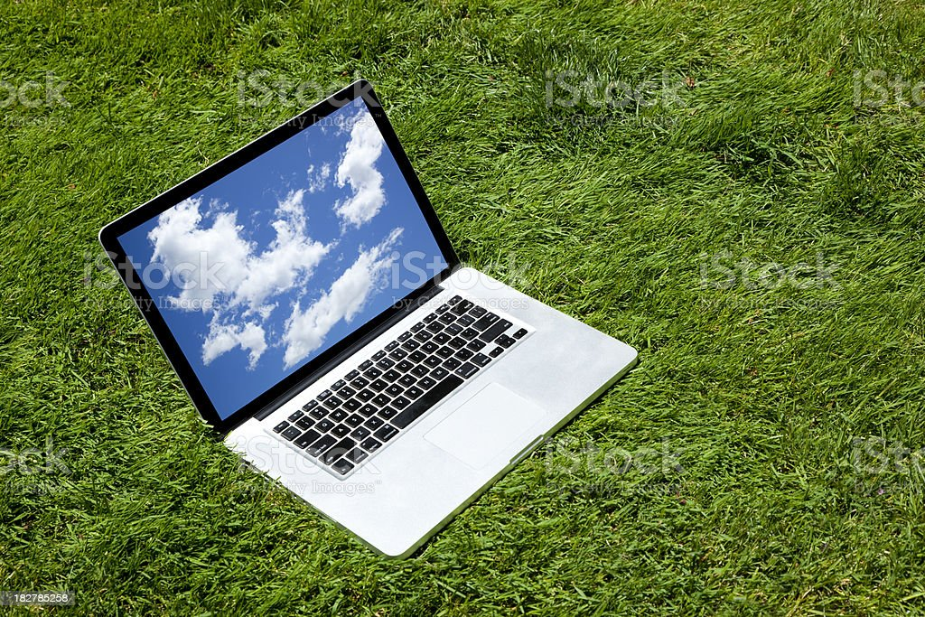 open laptop on the grass royalty-free stock photo