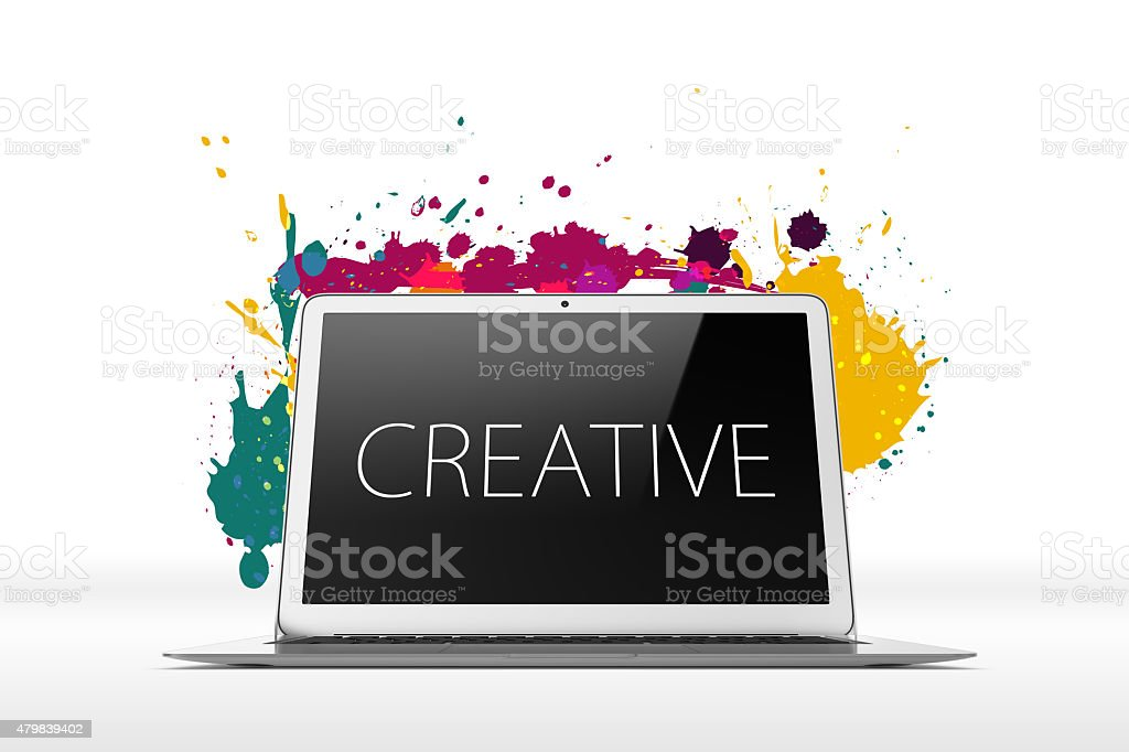 Open laptop on white background with splatters stock photo
