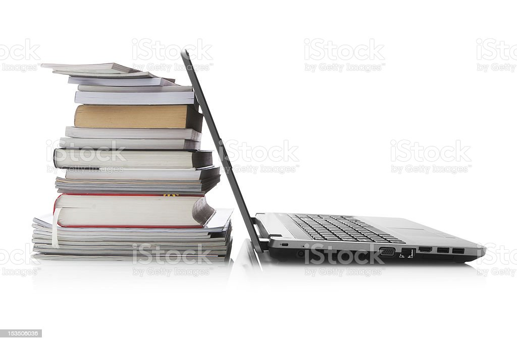 Open laptop screen leaning against a stack of books royalty-free stock photo