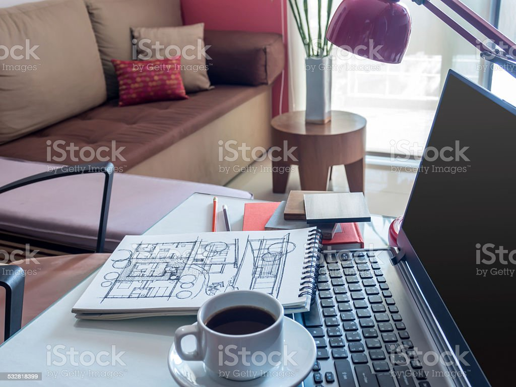 Open laptop with architectural drawing  on desktop in modern office stock photo