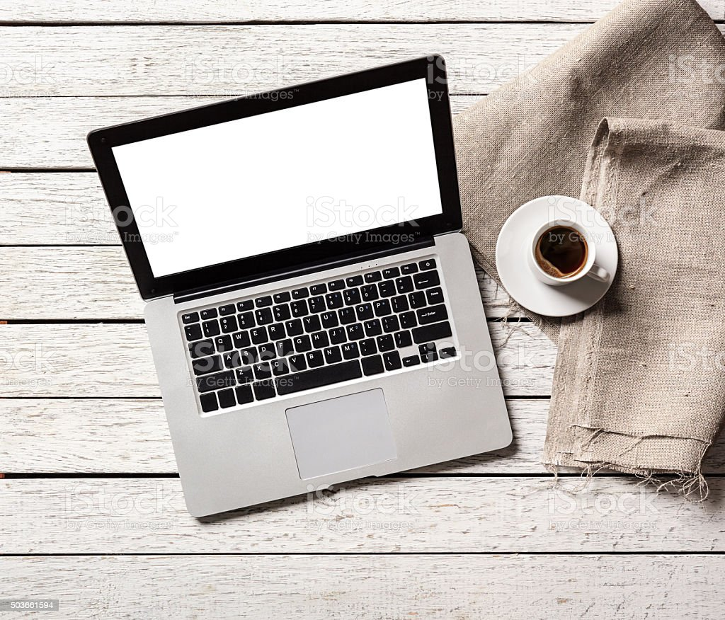 Open laptop with coffee cup stock photo