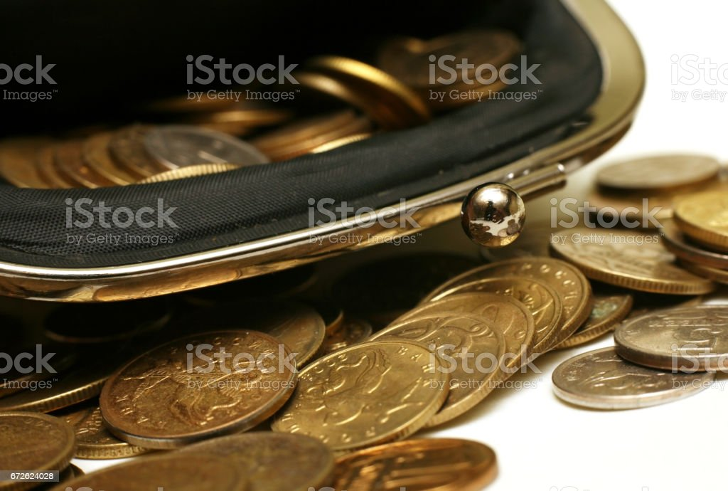 Open leather pouch with Russian coins stock photo
