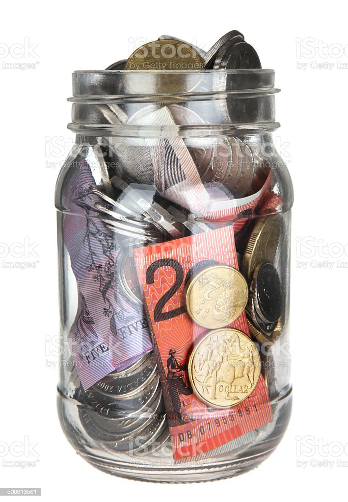 Open Lid Jar of Australian Money on White stock photo