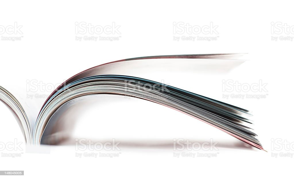 Open magazine on white background stock photo