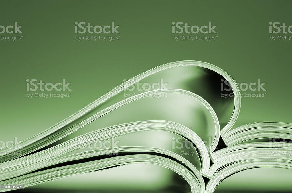 Open Magazines Piled on Table, Toned stock photo
