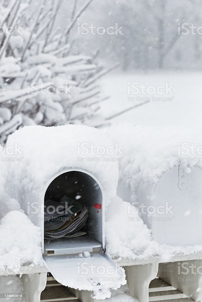 Open Mailbox in Blizzard Snow royalty-free stock photo
