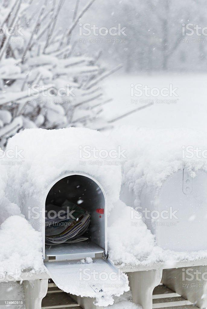 Open Mailbox in Blizzard Snow stock photo