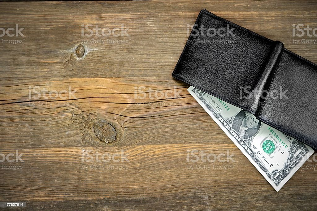 Open Male Black Leather Wallet With One Dollar Bill stock photo