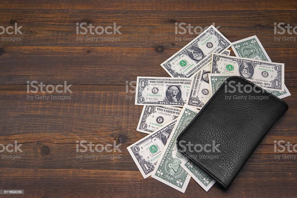 Open Male Black Leather Wallet With One Dollar Bills stock photo