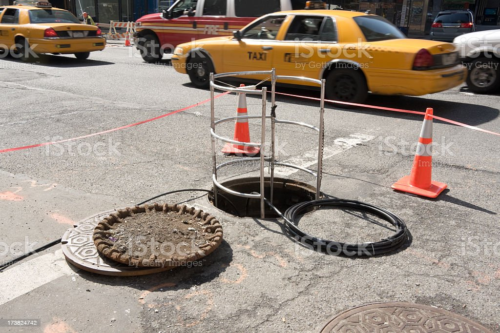open manhole cover in New York City stock photo