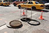 open manhole cover in New York City